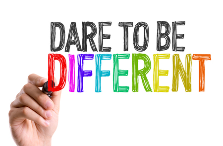 Dare to be different written with a marker pen