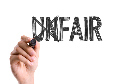 unfair: Unfair written with a marker pen Stock Photo