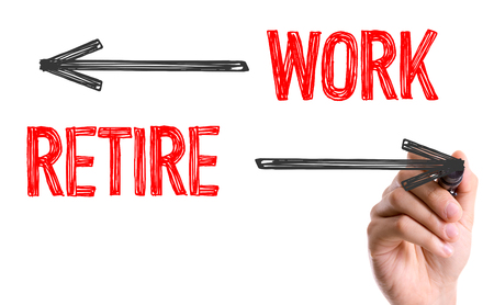 retire: Work and retire written with a marker pen