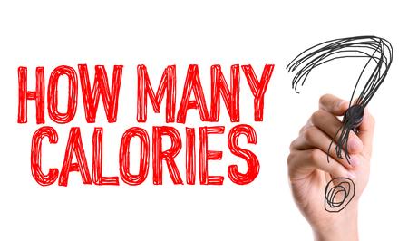 Hoeveel calorieën? geschreven met een marker pen Stockfoto - 60382772
