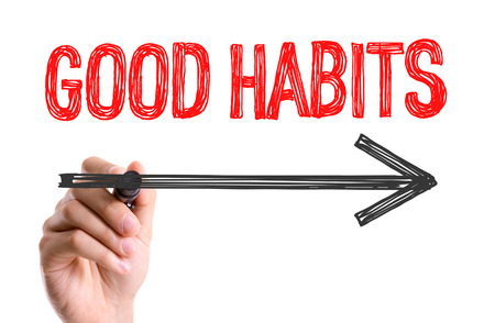 active arrow: Good habits written with a marker pen