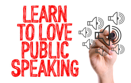 extrovert: Learn to love public speaking written with a marker pen