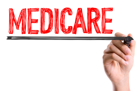 medicare: Medicare written with a marker pen Stock Photo