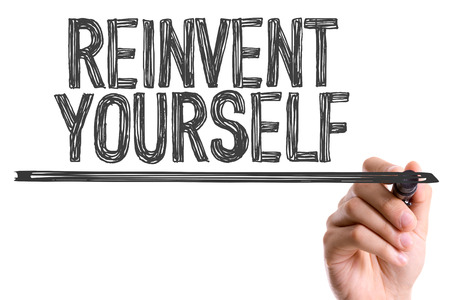 revitalize: Reinvent yourself written with a marker pen