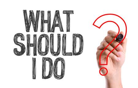 Wat moet ik doen? geschreven met een marker pen Stockfoto