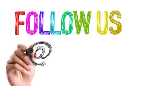 Follow us written with a marker pen