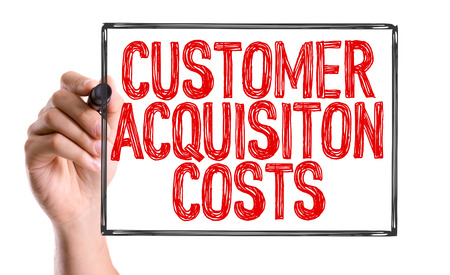 acquisition: Customer acquisition costs written with a marker pen