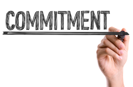 committed: Commitment written with a marker pen