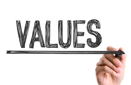 by virtue: Values written with a marker pen Stock Photo
