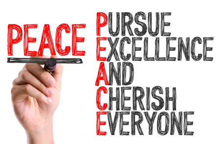 pursue: Peace acronym written with a marker pen Stock Photo