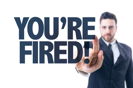 terminated: Business man pointing the text: Youre Fired!