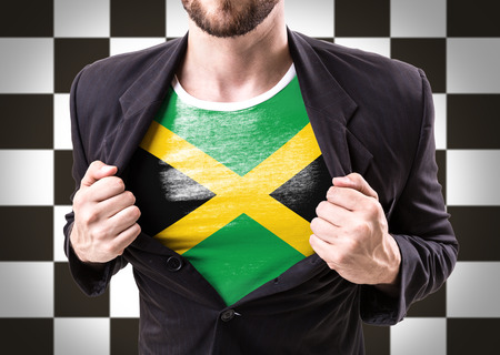 Businessman stretching suit with Jamaica flag on checkered background