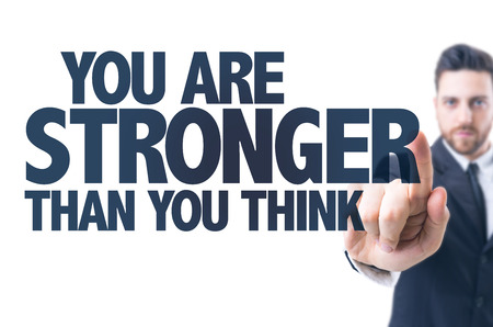 stronger: Business man pointing the text: You are stronger than you think