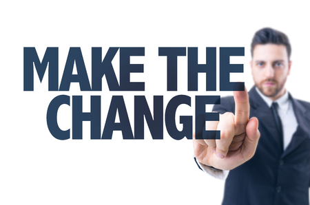 Business man pointing the text: Make the change Stock Photo