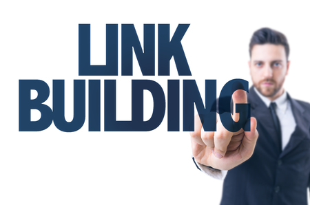 link building: Business man pointing the text: Link building Stock Photo