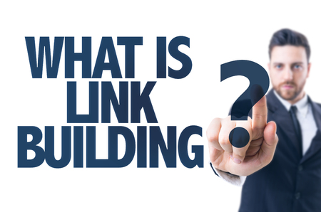 backlink: Business man pointing the text: What is link building? Stock Photo