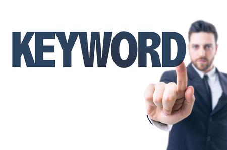 keyword: Business man pointing the text: Keyword