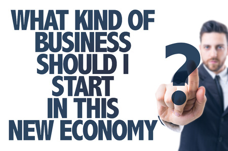 new economy: Business man pointing the text: What kind of business should I start in this new economy?