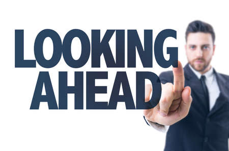 looking ahead: Business man pointing the text: Looking ahead
