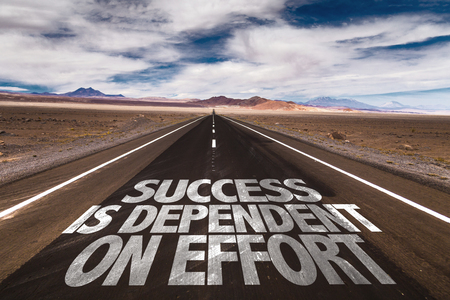dependent: Success is dependent on effort written on the road
