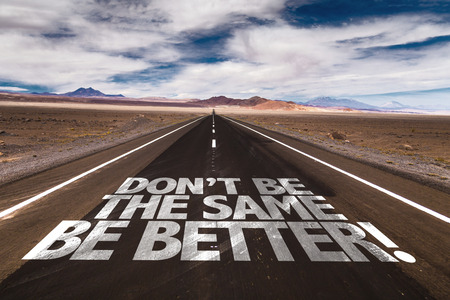 Don't be the same, be better! written on the road Archivio Fotografico