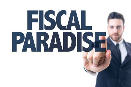 fiscal: Business man pointing the text: Fiscal paradise Stock Photo