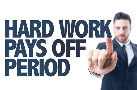 difficult period: Business man pointing the text: Hard work pays off period Stock Photo
