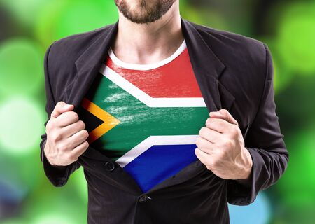 south africa flag: Businessman stretching suit with South Africa flag on bokeh background Stock Photo