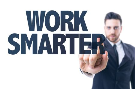 smarter: Business man pointing the text: Work smarter Stock Photo