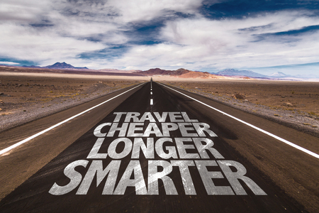 cheaper: Travel cheaper longer smarter written on the road