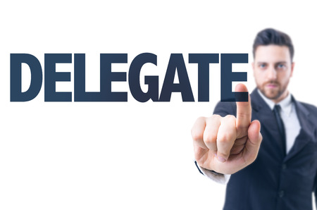 delegate: Business man pointing the text: Delegate