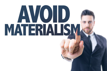 materialism: Business man pointing the text: Avoid materialism Stock Photo