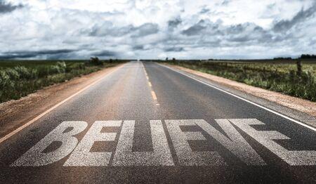 Believe written on the road