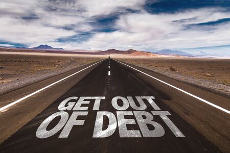bank records: Get out of debt written on the road Stock Photo