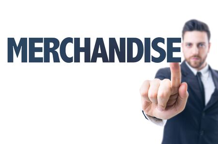 merchandiser: Business man pointing the text: Merchandise Stock Photo