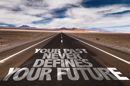 defines: Your past never defines your future written on the road