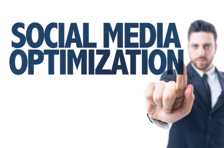 Business man pointing the text: Social media optimization Stock Photo