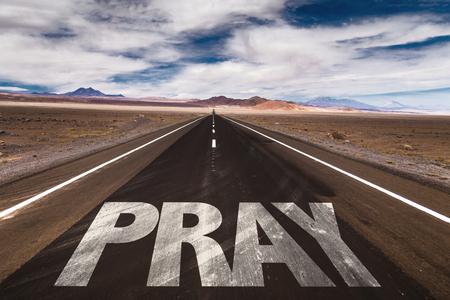 worshipper: Pray written on the road