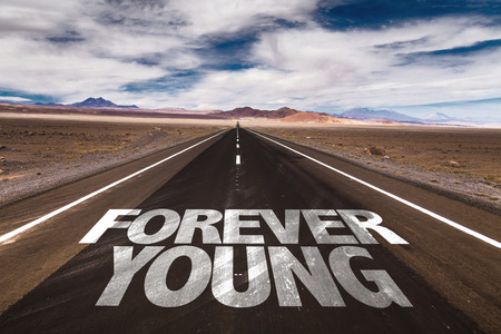 forever: Forever young written on the road Stock Photo