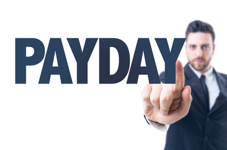 payday: Business man pointing the text: Payday Stock Photo