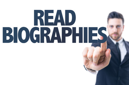 memoir: Business man pointing the text: Read biographies Stock Photo
