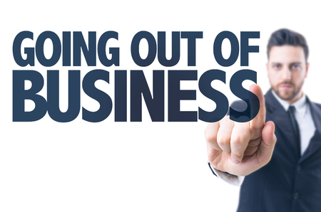 going out: Business man pointing the text: Going out of business