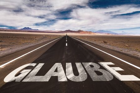 glaube: Glaube (believe in German) written on the road