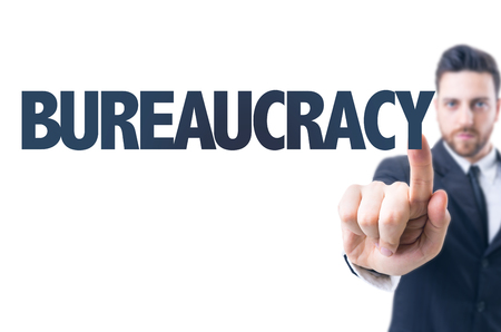 contractual: Business man pointing the text: Bureaucracy