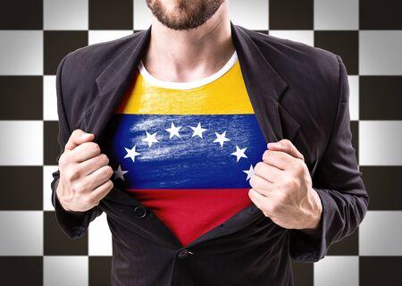 venezuela flag: Businessman stretching suit with Venezuela flag on checkered background Stock Photo