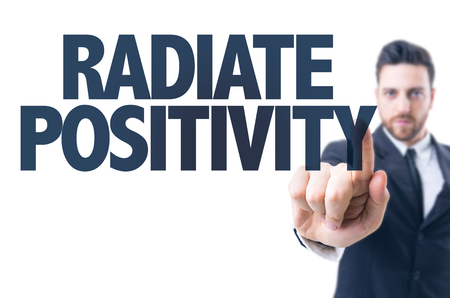 positivity: Business man pointing the text: Radiate positivity Stock Photo