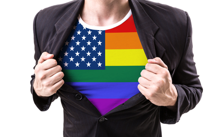Businessman stretching suit with USA LGBT flag on white background