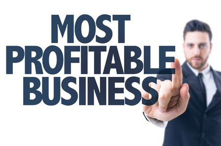 profitable: Business man pointing the text: Most profitable business Stock Photo