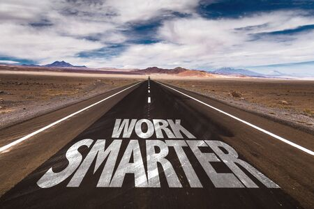 solutions freeway: Work smarter written on the road Stock Photo