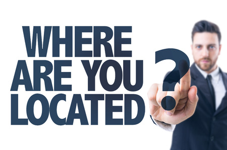 localization: Business man pointing the text: Where are you located?